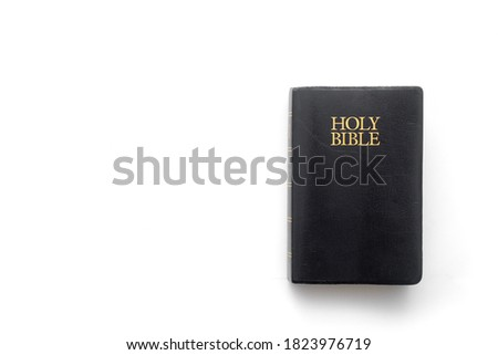 Holy Bible on white with copy space Royalty-Free Stock Photo #1823976719