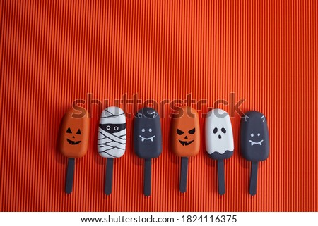 Set of ice cream with halloween character face on orange background. Halloween party background