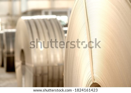 Warehouse of metal coils. Industrial production and logistics concept. Roll of steel sheet in a plant. #1824161423
