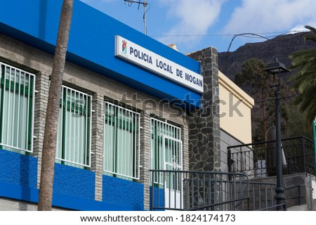 Gran Canaria Mogan White houses, architecture. Here the police station with inscription in Spanish - Police station De Moogan #1824174173
