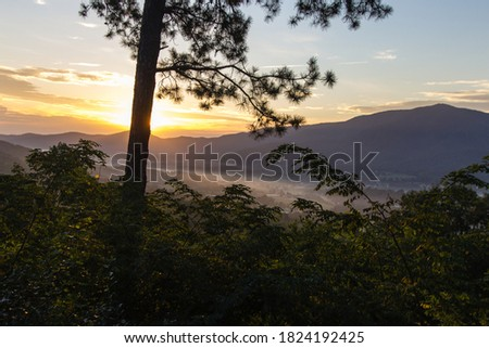 Morning Sunrise On Foothills Parkway. Sunrise over a misty valley as seen from a scenic overlook on the recently opened section of the Foothills Parkway from Wears Valley to Townsend Tennessee.