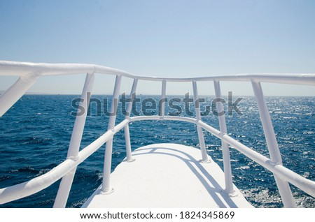 view of the blue sea water from the yacht. summer vacation on a boat. white the railing of the ship. the water from the boat