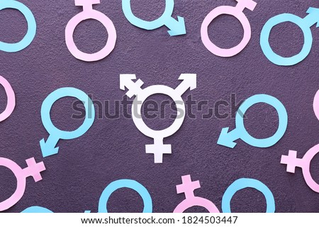Symbols of man, woman and transgender on dark background Royalty-Free Stock Photo #1824503447