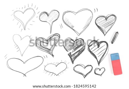 Hearts hatching set and collection, sketching with rubber eraser and graphite stick isolated on white background, top view