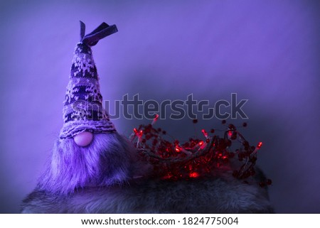 Christmas elf with red lights in purple ambient