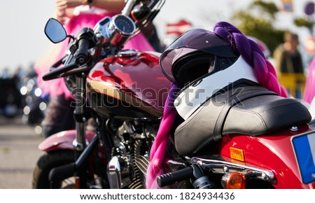 Driving a motorcycle in a sunny day. Royalty-Free Stock Photo #1824934436
