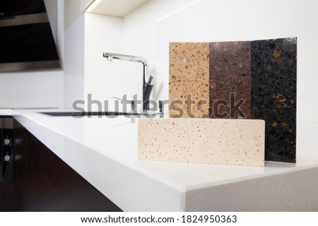 Different quartz kitchen counter top samples on white polished countertop with precise processed edges. Royalty-Free Stock Photo #1824950363