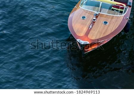 old speedboat on como lake - italy Royalty-Free Stock Photo #1824969113