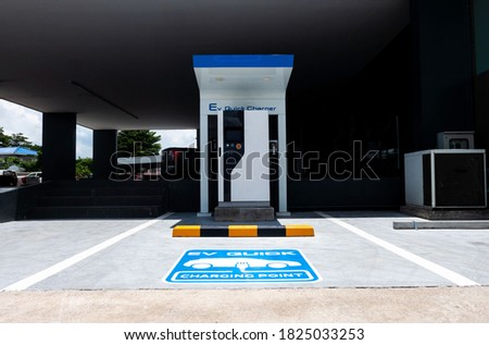 charging station for electric vehicle.outdoor car parking . blue sign EV quick charging point .