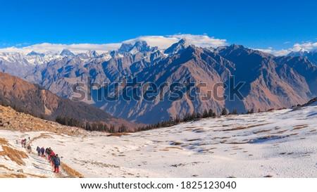 Himalayas as seen during the Kuari Pass Trek, India. Royalty-Free Stock Photo #1825123040