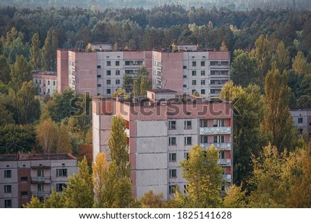 Selective focus, View of the lost city of Pripyat. empty concrete floors overgrown with trees. Pripyat is empty after the evacuation after accident at the Chernobyl nuclear power plant #1825141628