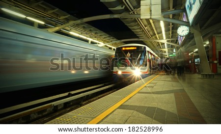 BANGKOK, THAILAND - JULY 16, 2013: People at BTS Skytrain waiting for train. 600,000 passengers ride the Skytrain daily #182528996