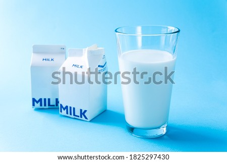 Close-up picture of milk in a glass and milk carton