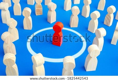 The red man keeps his distance in people crowd. Personal space, comfort zone. Protection of physical and mental health, keep away from dangers. Maintaining distance to avoid contact and infection. Royalty-Free Stock Photo #1825442543