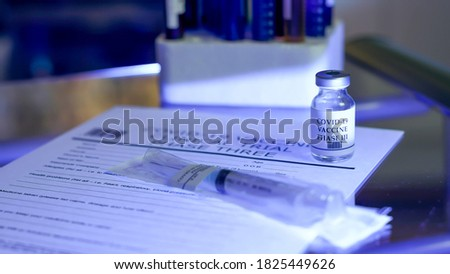 COVID-19 vaccine and other paraphernalia for Phase III trials Royalty-Free Stock Photo #1825449626