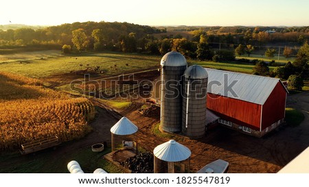Countryside scenery at Fall season. Autumn colors. Harvest, harvesting time. Rural landscape. Aerial, view from above of the Farm Royalty-Free Stock Photo #1825547819