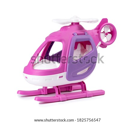 Plastic toy pink helicopter isolated on white background.
