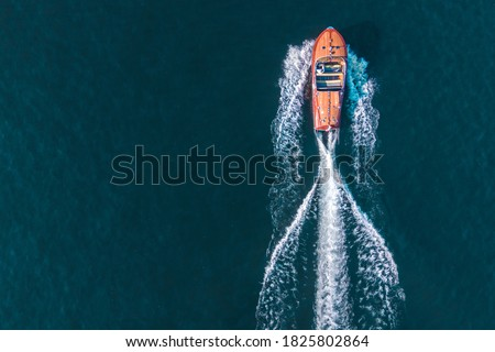 Old boat on lake como Italy -  speedboat from drone Royalty-Free Stock Photo #1825802864