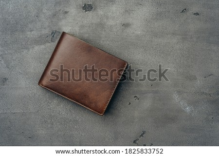 New brown leather wallet on dark background Royalty-Free Stock Photo #1825833752