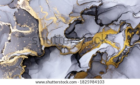 Closeup of black and shiny golden alcohol ink abstract texture, trendy wallpaper. Art for design project as background for invitation or greeting cards, flyer, poster, presentation, wrapping paper Royalty-Free Stock Photo #1825984103