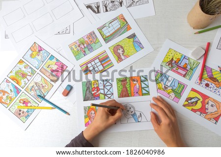 Drawing a colored storyboard. The illustrator creates comics on paper.