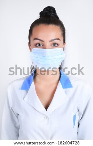 Young nurse doctor in a  medicine mask studio isolated #182604728