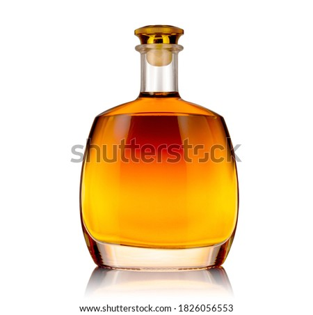 Bottle of premium alcohol, isolated on white background. Ideal for mock-up design. Royalty-Free Stock Photo #1826056553