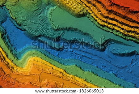 Model of a mine elevation. GIS product made after processing aerial pictures taken from a drone. It shows excavation site with steep rock walls Royalty-Free Stock Photo #1826065013