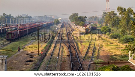 Drone Picture facing west of the Faisalabad railway station track stock photo.