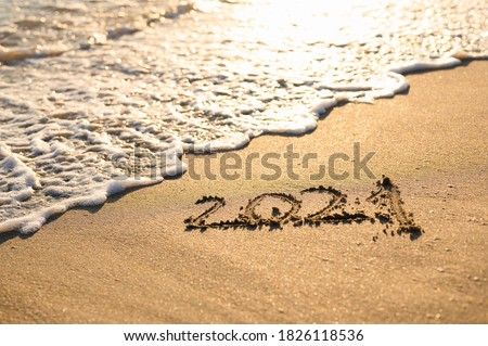 Sandy beach, sea wave and the inscription 2021. New Year 2021 Concept #1826118536