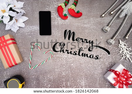 Merry Christmas  and Happy New Year holiday decoration with  construction tools. Plumber Christmas.