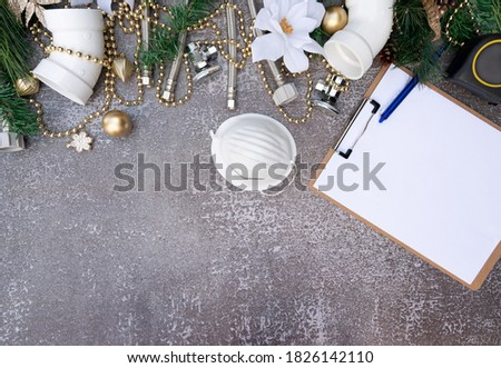 Christmas and New Year holiday decoration with face mask, construction tools on the wooden background top view. Plumber christmas.