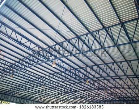 Dome roof structure and metal sheet. Blue steel pipe frame with hanging lamp. Selective focus #1826183585