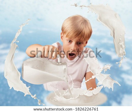Milk splash. Realistic milk splash and dragon figurine made from milk or yogurt drop. The boy sees the dragon fly out of the milk.