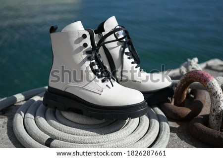 white leather boots from the new collection of fashionable shoes made of eco-leather fall-winter 2020. macro photo Royalty-Free Stock Photo #1826287661