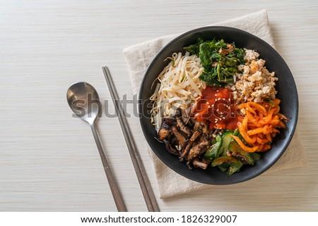 Bibimbap, Korean spicy salad with rice bowl - traditionally Korean food style Royalty-Free Stock Photo #1826329007