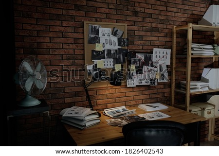Detective workplace near brick wall in office Royalty-Free Stock Photo #1826402543