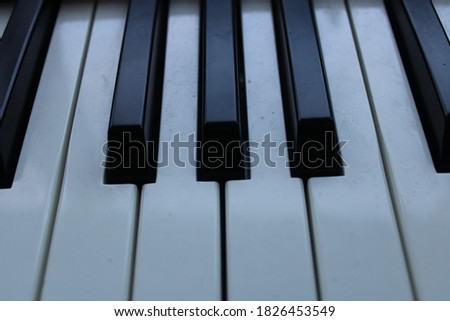 Black and white musical piano keyboard keys for music and arts #1826453549