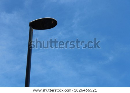 Street light lamp post against clear blue summer sky in the day time #1826466521