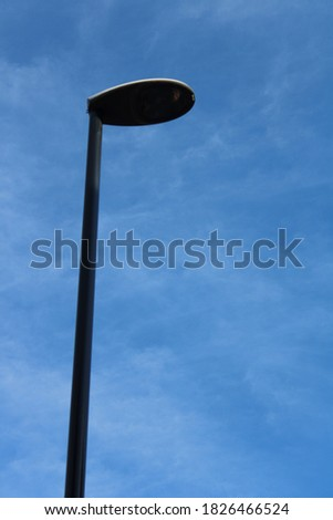Street light lamp post against clear blue summer sky in the day time #1826466524