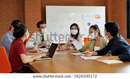 Businessmen are meeting conference about work in meeting room and everyone wear the medical mask for protect Germs or bacteria and Covid-19. Royalty-Free Stock Photo #1826500172