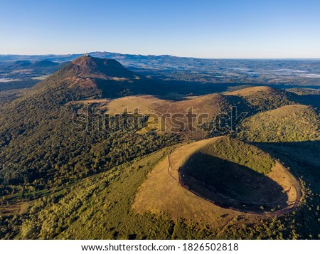 Aerial panorama of Puy Pariou and Puy de Dome volcanoes, Auvergne-Rhone-Alpes, France Royalty-Free Stock Photo #1826502818
