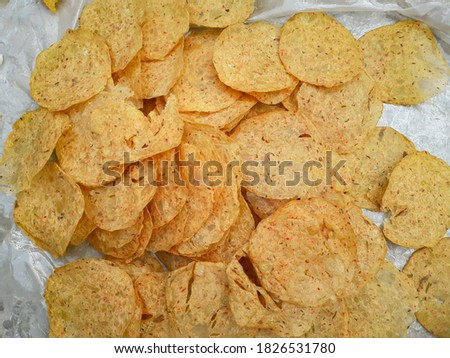 Homemade crunchy and delicious indian aaloo zeera papad(chips) closeup picture