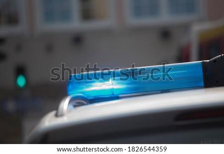 Blue light signal on a police car, visual emergency signal
