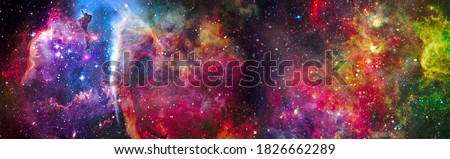 Incredibly beautiful galaxy in outer space. Nebula night starry sky in rainbow colors. Multicolor outer space. Elements of this image furnished by NASA. Royalty-Free Stock Photo #1826662289