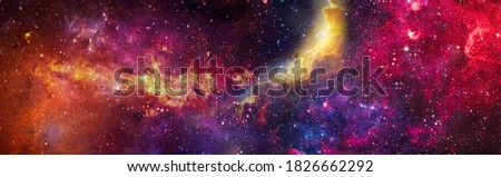 Incredibly beautiful galaxy in outer space. Nebula night starry sky in rainbow colors. Multicolor outer space. Elements of this image furnished by NASA. Royalty-Free Stock Photo #1826662292
