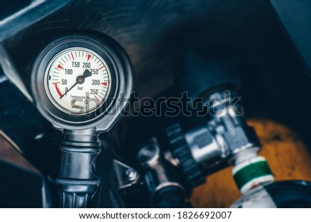 Fire service breathing apparatus with pressure gauge in the fire engine shows 0 bar Royalty-Free Stock Photo #1826692007