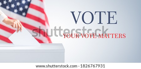 The voter holds his vote ballot paper and places it in the ballot box. Filling in ballots and casting votes in booths at polling station.The concept of free democratic vote elections. Royalty-Free Stock Photo #1826767931