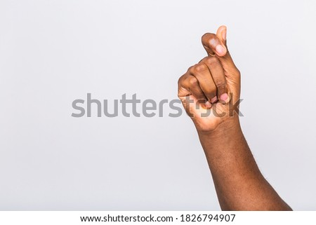 Afro-American black man's hand showing different gestures on white background, closeup view of hands. Royalty-Free Stock Photo #1826794907
