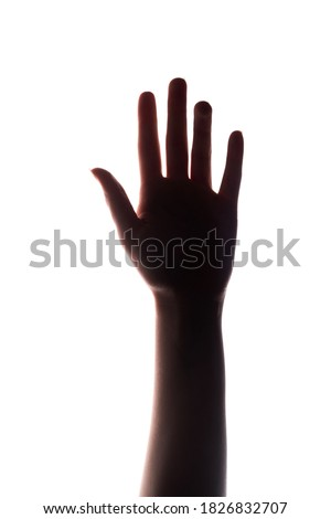 Hand silhouette. Voting right. Female arm reaching up isolated on white copy space background. Help support. Ambition confidence. Success independence. Royalty-Free Stock Photo #1826832707